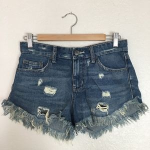 Free People mid rise distressed cut off shorts